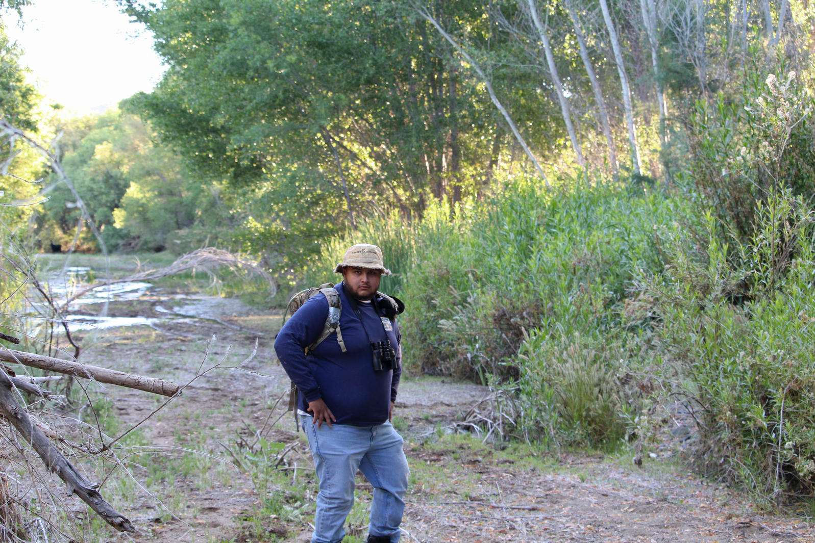 River Pathways intern Max Ayala poses with his field gear near the Agua Fria River.