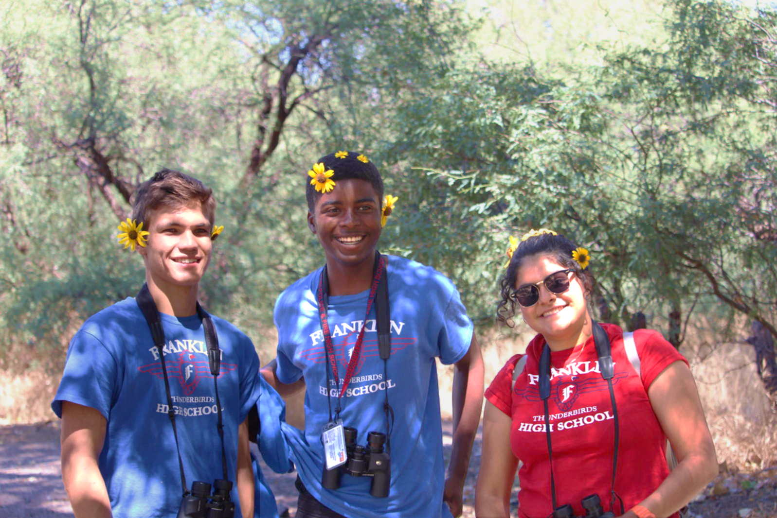 High school students pose with flowers on a River Pathways field trip to Agua Fria National Monument.