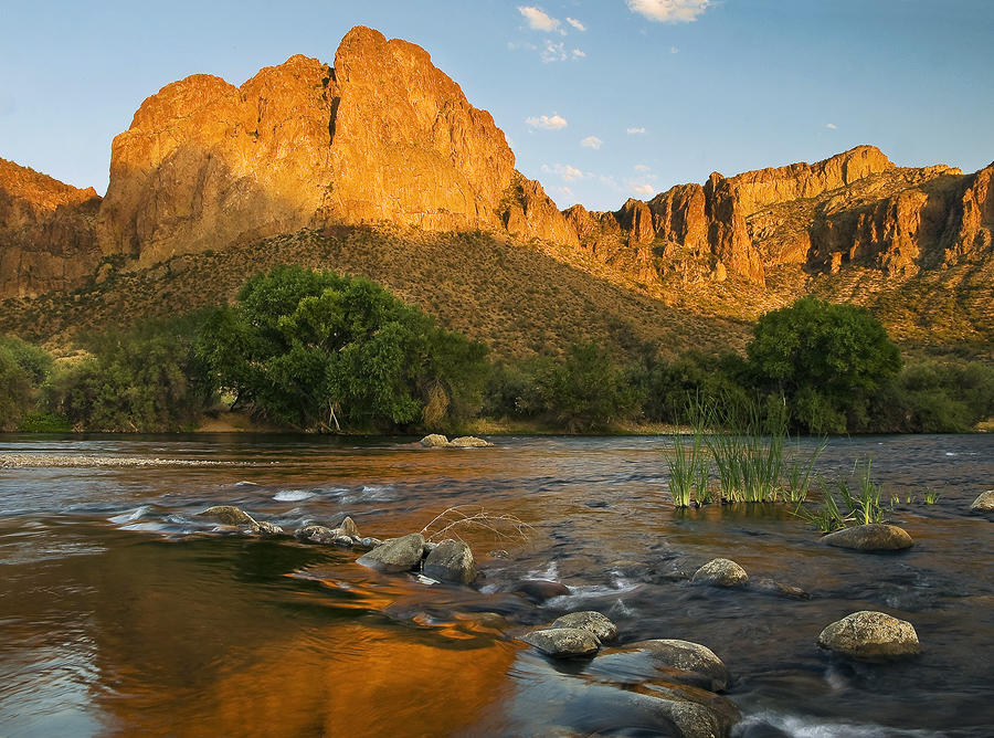 Sun soaked Goldfield Mountains glow above the lower Salt River