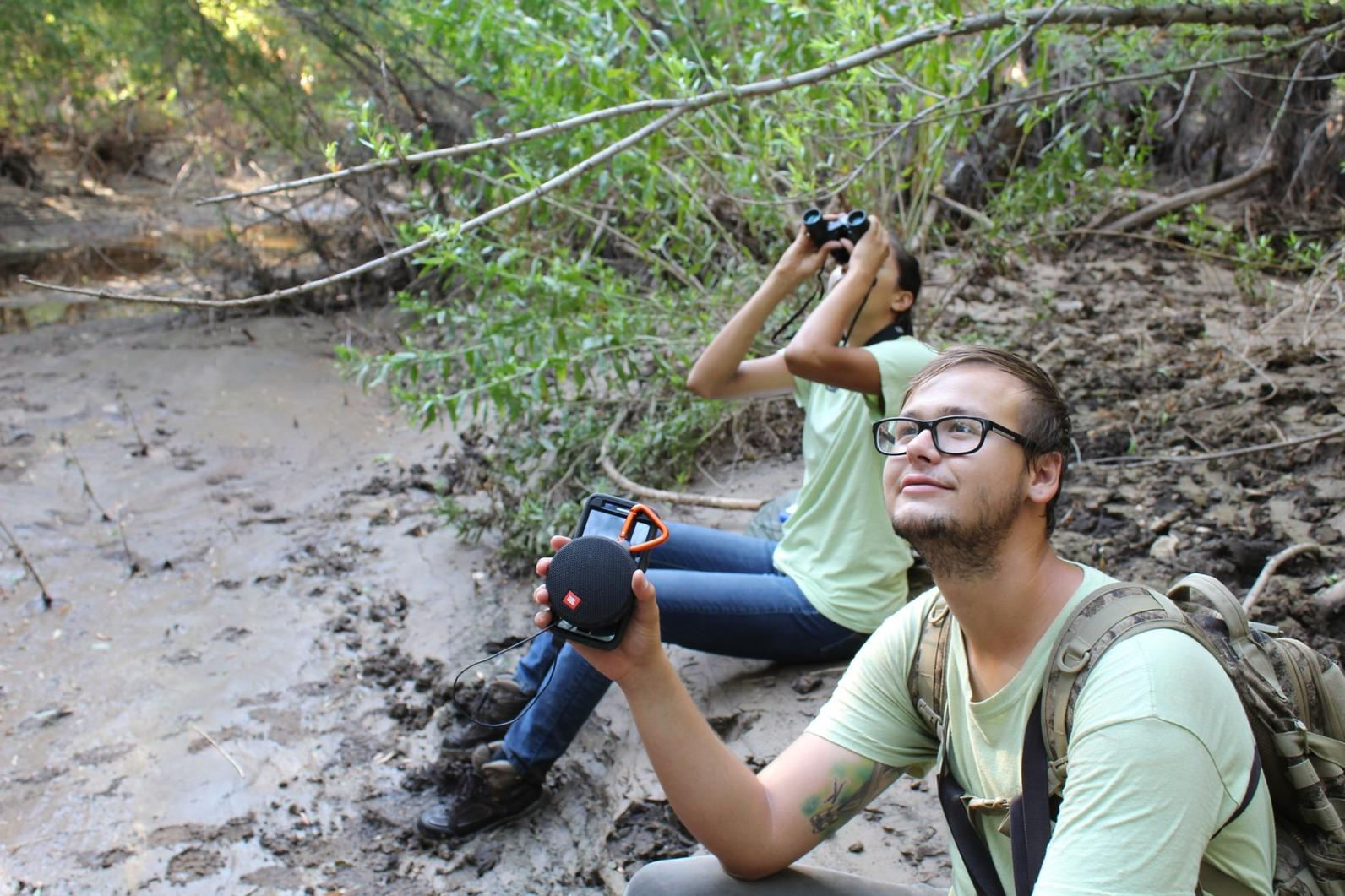 Daniel Hite and Nyah Torres, a River Pathways Intern, sit beside the Agua Fria River as they wait for a Western Yellow-billed Cuckoo to arrive.