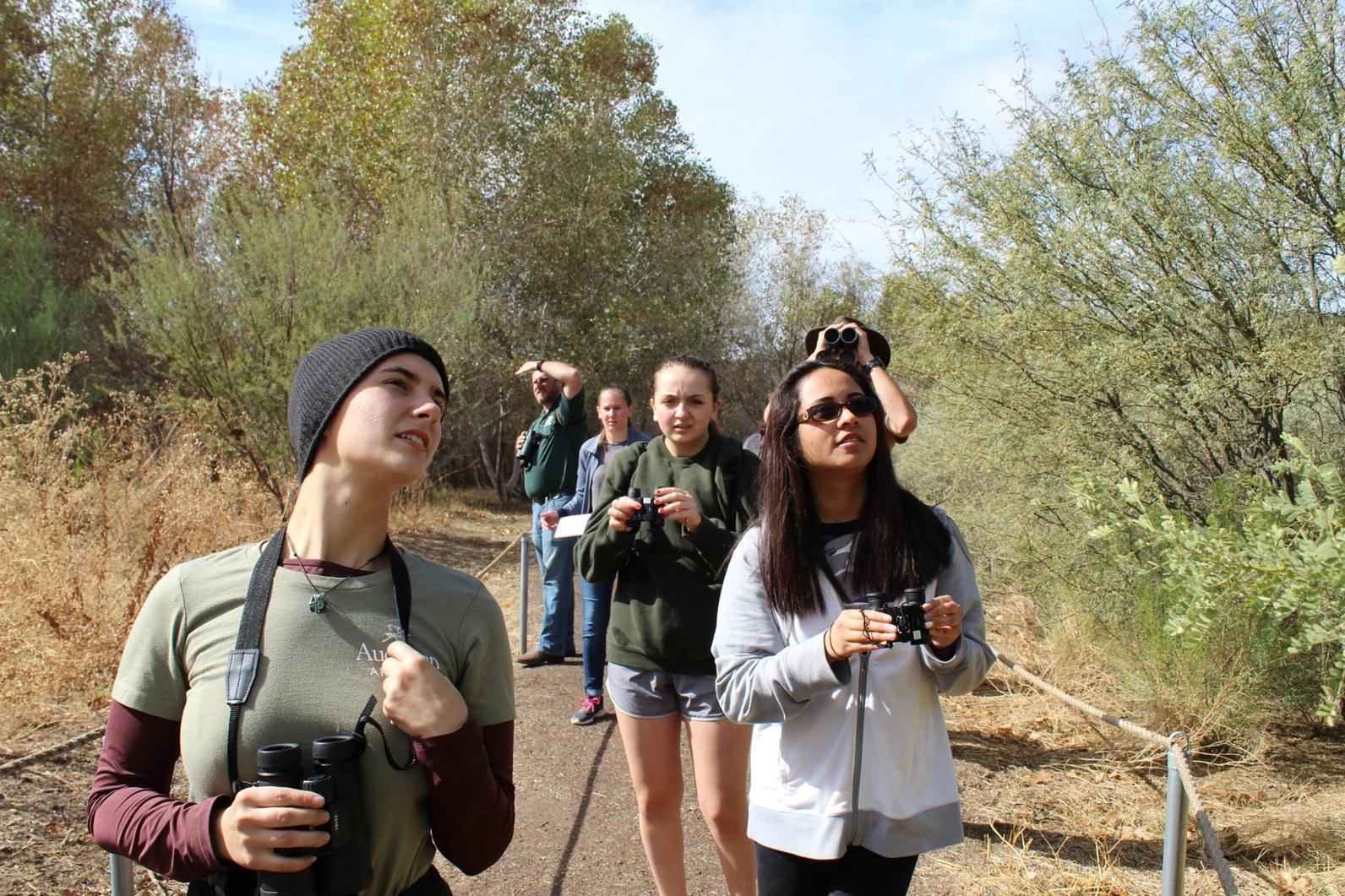 Mia McGehee leads a bird walk during a River Pathways field trip to Black Canyon Heritage Park.